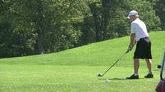 Golfer teeing off - stock footage