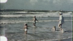 Children Run into Beach Waves Seashore Summer 1960s Vintage Film Home Movie 1908 Stock Footage