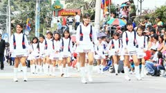 BANOS, ECUADOR - 16 DECEMBER 2011: Young students parade for the anniversary of Stock Footage