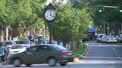 Antique clock on median strip (1 of 2) Stock Footage