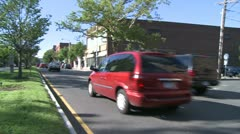 Traffic going down road with grassy median strip  (1 of 2) Stock Footage