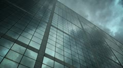 Ominous sky reflected in a glass office building - timelapse Stock Footage