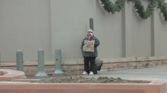 Homeless woman on street corner during Christmas P HD 8709 Stock Footage