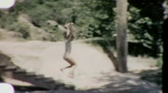 Jumping into Swimming Hole Pool Circa 1960 (Vintage Home Movie Footage) 1915 Stock Footage