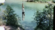 Stock Video Footage of Boy Jumping into SWIMMING HOLE Pool 1960s Vintage Film Home Retro Movie 1914