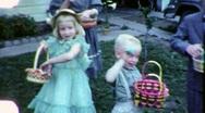 Stock Video Footage of CHILDREN EASTER EGG HUNT Baskets Kids 1960s (Vintage Film Home Movie) 1920