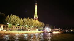 The Eiffel tower at night from the River Seine - stock footage