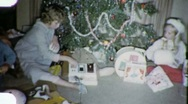 Stock Video Footage of XMAS MORNING Open PRESENTS KIDS Christmas 1960s (Vintage Film Home Movie) 1924