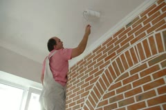 Worker painting the ceiling Stock Footage