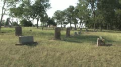Well kept graves and peaceful reflection at Antioch Colony Cemetery Stock Footage