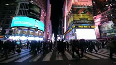 Times Square New York City NYC NY people walking  crossing street crowd at night Stock Footage