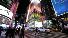 Ambulance 911 Times Square New York City NYC NY cars traffic yellow cab at night - stock footage