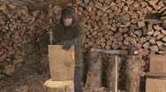 Stock Video Footage of Man Hacks Off Finger Chopping Wood
