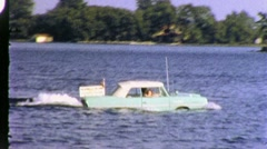 Boat Amphibious Stunt Car Drives Across Lake 1960s Vintage Film Home Movie 1938 Stock Footage