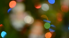 Defocused image of shone bulbs on a christmas-tree Stock Footage