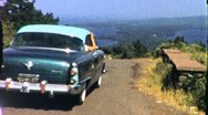 Stock Video Footage of Chevy Drives Over Hilltop Chevrolet Classic CAR Vintage Film Home Movie 1954