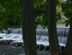 Water flowing over dam spillway - 2K Stock Footage