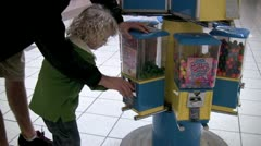 Buying gum from machine Stock Footage