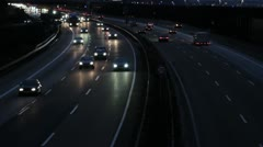 Traffic on highway at night Stock Footage