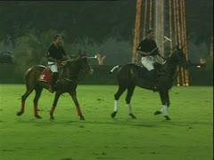 Sultan of Brunei and Prince Charles on horseback during polo match. Stock Footage