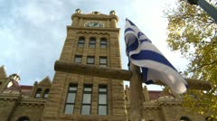 Israel flag and city hall low angle, during political protest Stock Footage