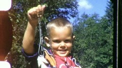 Proud LITTLE BOY with Small Fish Trout Child 1960s  Vintage Film Home Movie 1972 - stock footage