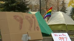 Protest, Occupy (wall street) Calgary tents 99 percent Stock Footage