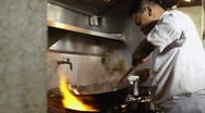 Stock Video Footage of Professional chef cooking in Asian restaurant kitchen