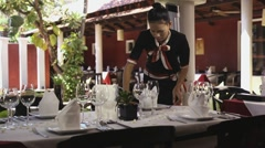 Beautiful Asian waitress working in restaurant Stock Footage