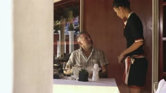 Asian waitress talking with client in luxury restaurant - stock footage