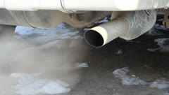 Exhaust gases from the muffler running car. HD H.264 - stock footage