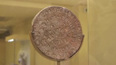 Phaistos Disk, unknown writing script, Minoan Palace of Phaestos, Crete, Greece Stock Footage