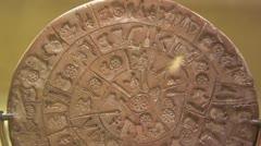 Phaistos Disk, unknown writing script, Minoan Palace of Phaestos, Crete, Greece Stock Footage