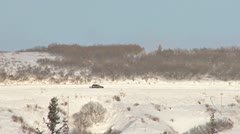 SUV Driving Left to Right on Snowy Road 2 Stock Footage
