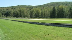 View of race from grassy sideline Stock Footage