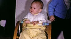 Cute Baby Girl in Rocking Chair Plays 1970s Vintage Film Home Movie 1988 Stock Footage