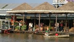 Floating market on Tonle Sap Lake, Cambodia Stock Footage