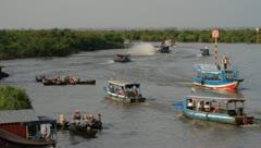 Ships around floating village on Tonle Sap Lake, Cambodia Stock Footage