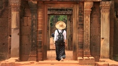 Woman entering Angkor Temple, Banteay Srey Stock Footage