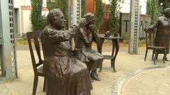 Politics and Protest, Occupy (wall street) Calgary famous five statue defaced Stock Footage