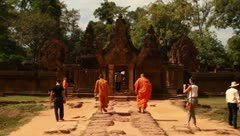 Tourists and monks in Angkor Temple, Banteay Srey Stock Footage