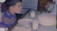 Stock Video Footage of Great Shot Boy Blows Birthday Candles Circa 1960 (Vintage Film Home Movie) 2001