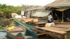 Floating village on Tonle Sap Lake, Cambodia Stock Footage