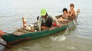 Stock Video Footage of Men bailing water out of boat on Tonle Sap Lake, Cambodia