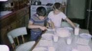 Happy Boys Chop Birthday Cake Circa 1960 (Vintage Film Home Movie) 2002 Stock Footage