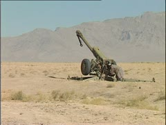 Taliban fighter has trouble firing Howitzer - stock footage