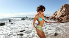 Bikini model dancing wild beach mexico Stock Footage