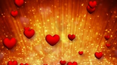 Heart shapes and golden particles rising up loop Stock Footage