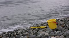 Baby toys on seaside Stock Footage