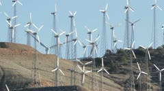 Hill of Big and Small Green Energy Wind Mills Stock Footage
